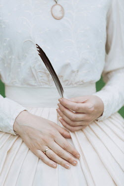 Magdalena Russocka close up of historical woman's hands holding feather