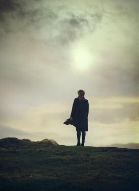 Mark Owen LONE WOMAN STANDING IN FIELD Women
