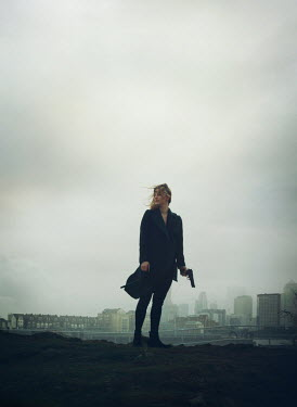 Mark Owen WOMAN IN CITY HOLDING GUN Women