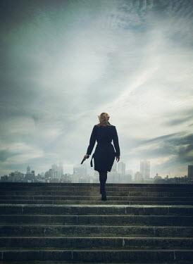 Mark Owen WOMAN WITH GUN WALKING UP URBAN STEPS Women