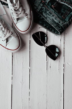 Maria Petkova SNEAKERS WITH SUNGLASSES AND JEANS ON FLOORBOARDS Miscellaneous Objects
