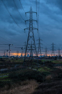 Colin Hutton ELECTRICITY PYLONS AND CITYSCAPE Specific Cities/Towns