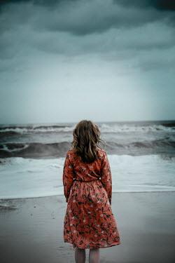 Rekha Garton WOMAN IN RED DRESS WATCHING STORMY SEA Women