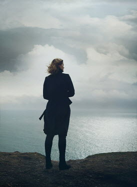 Mark Owen WOMAN ON CLIFFTOP LOOKING OUT TO SEA Women