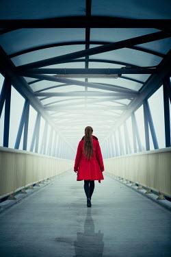 Magdalena Russocka modern woman walking on footbridge