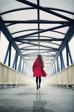 Magdalena Russocka modern woman running on footbridge