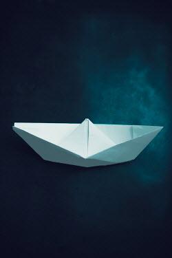 Ildiko Neer Close up of origami paper boat