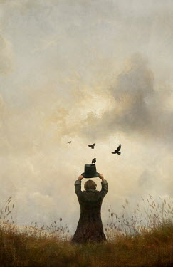 Jamie Heiden MAN HOLDING HAT WITH BIRDS IN FIELD Men