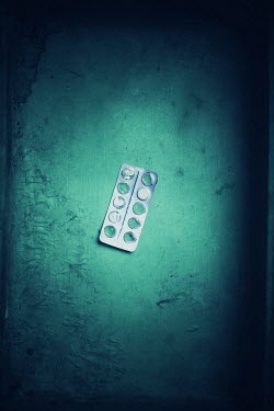 Ildiko Neer Medicine container with white pill