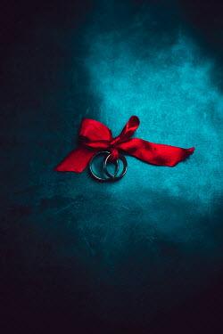 Ildiko Neer Two wedding rings on red ribbon