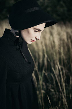 Magdalena Russocka close up of victorian woman standing in field
