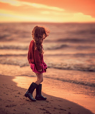 Lilia Alvarado GIRL IN BOOTS ON BEACH AT SUNSET Children