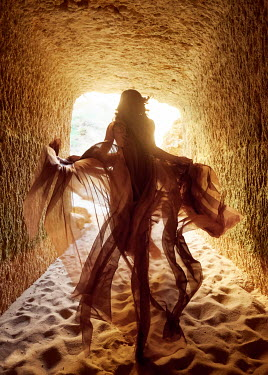 Chris Reeve WOMAN IN SANDY TUNNEL WITH FLOWING SILK Women