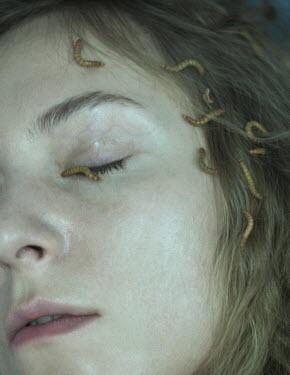 Daria Amaranth CLOSE UP OF MAGGOTS ON FEMALE FACE Women