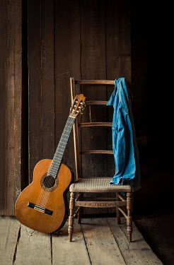 Jane Morley GUITAR LEANING ON WOODEN CHAIR