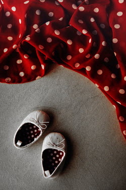 Maria Petkova white baby shoes and red dotted fabric Miscellaneous Objects