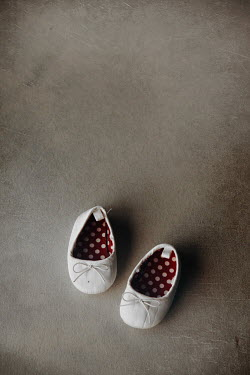 Maria Petkova white baby shoes with polka dots inside Miscellaneous Objects