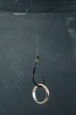 Magdalena Russocka wedding ring on fish hook underwater