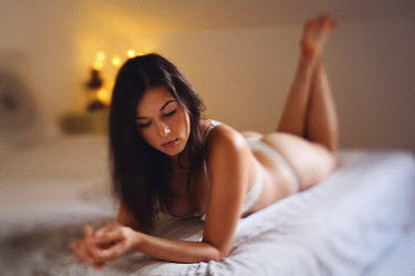 Remy Perthuisot BRUNETTE WOMAN IN UNDERWEAR LYING ON BED Women