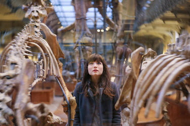 Remy Perthuisot GIRL IN MUSEUM LOOKING AT SKELETONS Women