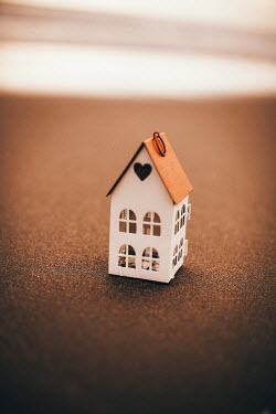 Nilufer Barin CLOSE UP OF MINIATURE HOUSE ON SANDY BEACH Miscellaneous Objects
