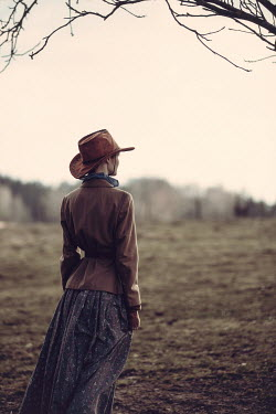 Magdalena Russocka historical woman in cowboy hat standing in field