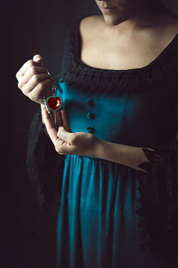 Ildiko Neer Medieval woman holding heart necklace