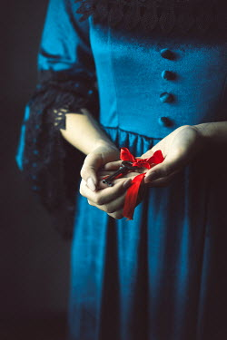 Ildiko Neer Medieval woman holding a key with red ribbon