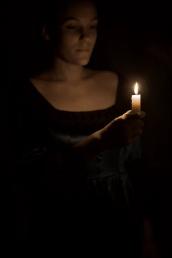 Ildiko Neer Medieval woman holding a candle