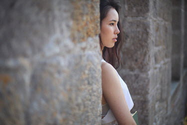 Remy Perthuisot ASIAN GIRL WATCHING FROM STONE BUILDING Women