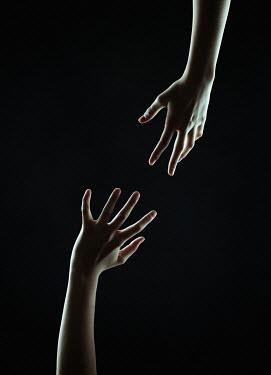 Magdalena Russocka two teenage girl's hands inside