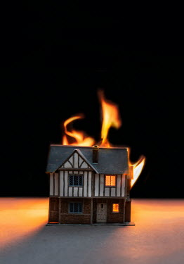 Stephen Mulcahey close up of miniature house on fire Miscellaneous Objects