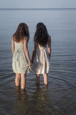 Michael Nelson TWO WOMEN PADDLING IN SEA Women