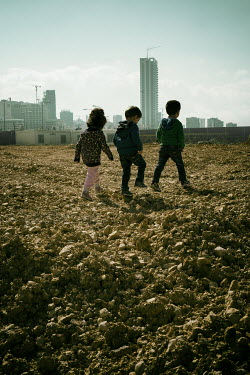 Mohamad Itani THREE LITTLE CHILDREN WITH CITY SKYLINE Children