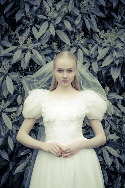 Nic Skerten YOUNG BRIDE STANDING IN GARDEN Women