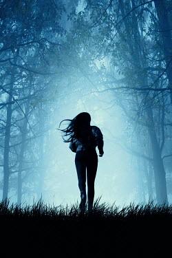 Magdalena Russocka modern woman running in woods