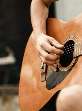 Nina Masic MAN PLAYING GUITAR Men
