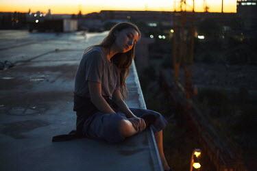 Dmitriy Bilous SAD GIRL SITTING BY BUILDING SITE AT NIGHT Women