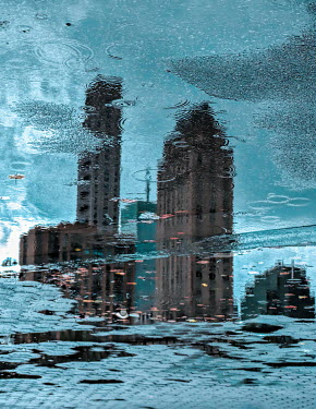 Elisabeth Ansley REFLECTION OF HIGH-RISE BUILDINGS IN PUDDLE Miscellaneous Buildings