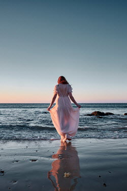 Chris Reeve WOMAN IN SILK DRESS PADDLING IN SEA Women
