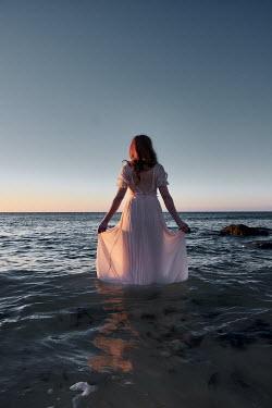 Chris Reeve WOMAN IN SILK DRESS STANDING IN SEA Women