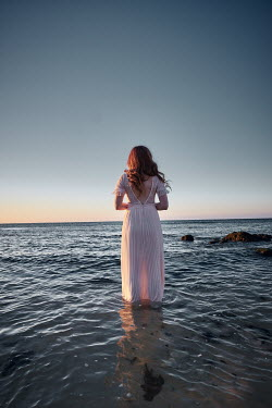 Chris Reeve WOMAN IN SILK DRESS STANDING IN OCEAN Women
