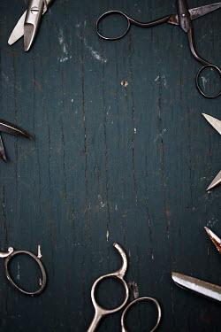 Alison Archinuk Metal scissors on blue wood Miscellaneous Objects