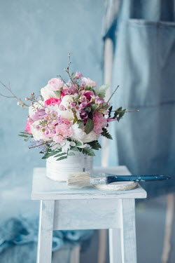 Magdalena Wasiczek FLOWERS IN PAINT POT WTH BRUSH ON TABLE Flowers