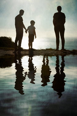 Miguel Sobreira Family Silhouette by Water Groups/Crowds