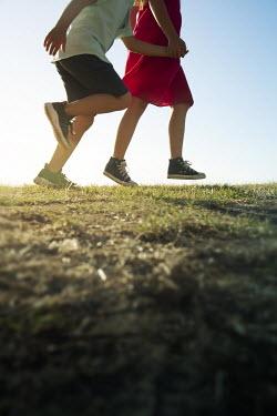 Miguel Sobreira Boy and Girl Running on Hill Children
