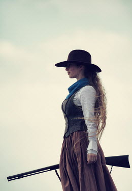 Magdalena Russocka historical woman in hat with gun in field Women