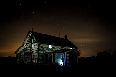 Rodney Harvey MAN OUTSIDE OLD WOODEN HOUSE AT NIGHT Men