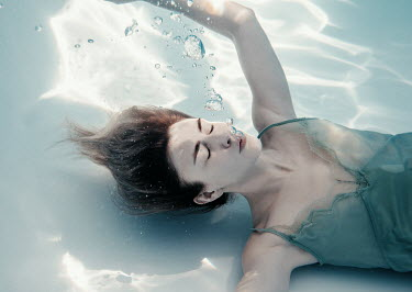 Rekha Garton GIRL UNDERWATER WITH BUBBLES AND DAPPLED LIGHT Women