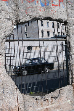 Ute Klaphake HOLE IN CONCRETE WALL AND RETRO CAR Cars